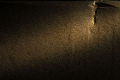 Background of old beige cardboard backlit with spotlight. Royalty Free Stock Image