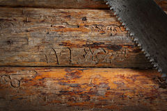Background from old boards with a saw Stock Photo
