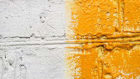Background.Old brick wall of the. building. White and yellow. colored facade. stock photography