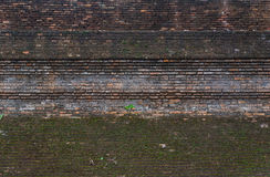 Background of old brick wall. With lichen stock image