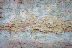 Background old brick wall with remnants of plaster. Background texture old brick wall with remnants of colored plasters Royalty Free Stock Photos