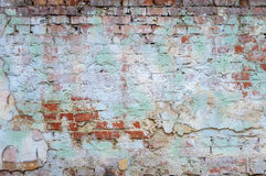 Background old brick wall with remnants of plaster. Background texture old brick wall with remnants of colored plasters Stock Photos