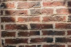 Background of old brick wall with sun shadow stock photo