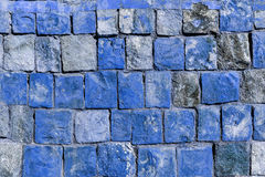 Background old broken the blue brick wall.  Stock Photos