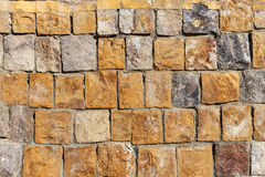 Background old broken brown yellow brick wall Royalty Free Stock Image