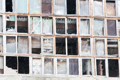 Background of old broken windows. Russian flag on the wall Royalty Free Stock Photos