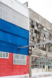 Background of old broken windows. Russian flag on the wall Stock Photo