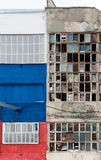 Background of old broken windows. Russian flag on the wall Stock Photos