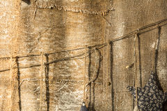 Background from an old burlap nailed to the wall Royalty Free Stock Images