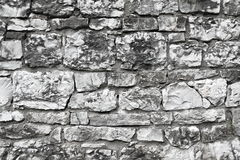 Old castle wall. Gray and white limestone used to build the castle walls. Background Royalty Free Stock Photography