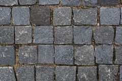 Background of old cobblestone pavement close-up. Abstract background of old cobblestone pavement close-up Royalty Free Stock Photography