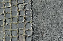 Background of old cobblestone road and asphalt Stock Photo