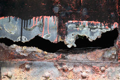 Background of an old cracked iron panel covered in rust Stock Images