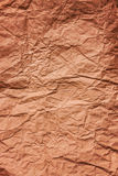 Background of old crumpled colored parchment paper Royalty Free Stock Images