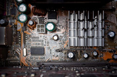 Background of old electronic circuit boards. In dark colors Stock Photos