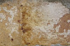 Old Brick of a Fireplace. Background of an old fireplace brick with rust, yellow, white and orangey red colors. Horizontal Stock Photos