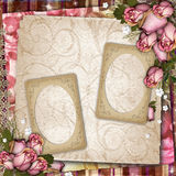 Background with old frames and dried roses. Pink and purple vintage  background with dried roses and paper frames Royalty Free Stock Photo