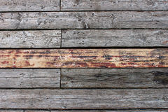 Background of old gray wooden boards. Shot down between them Stock Images