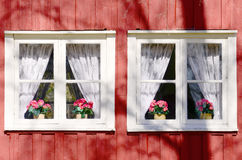 Background old house with windows. And details in red color Stock Photo
