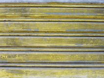 Background of old iron metal door in grungy style texture paint. With yellow color Stock Photos