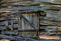 Background, Old Log Cabin Wall with Door Stock Images