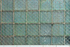 Background from the metal gauze of the chain-link and glass blocks. Background from the old metal gauze of the chain-link and glass blocks stock photo