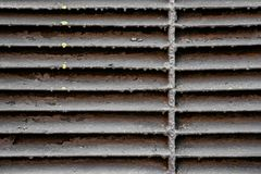 Background of old metal grill and yellow paint drops Royalty Free Stock Photos