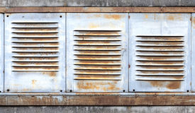 Background with old metal ventilation grille. Background with old rusted metal ventilation grille panels Stock Photography