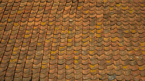 Background: old orange roof tiles Stock Images