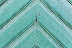 Background of old painted green boards Triangular pattern upwards. Background of old colored boards of bright green color with peeling paint with a Triangular Stock Photos