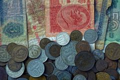 Texture of old paper banknotes and small Soviet coins royalty free stock photography