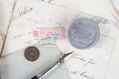 Background with old paper, old ink pen, handwriten letters and silver coins Stock Images