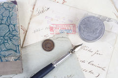 Background with old paper, old ink pen, handwriten letters and silver coins Stock Photos