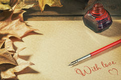 Background old paper pen fountain, foliage and inks  letter Royalty Free Stock Photography