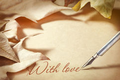 Background old paper pen fountain and foliage letter of love Royalty Free Stock Images