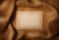 Background - old paper sheet. On jute background Stock Images