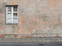 Background of old plastered cracked wall with a window Royalty Free Stock Images