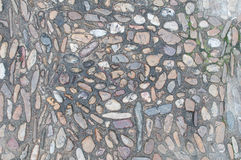 Background old real texture with stones and some grass. A photo of a real old background texture with stones and some grass Royalty Free Stock Photography