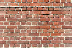 Background of old red brick wall. With scratches, holes and gaps stock photography