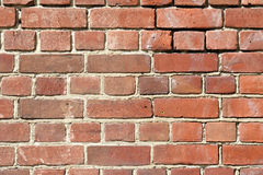 Background of old red brick wall. With scratches, holes and gaps royalty free stock image