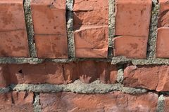Background of old red brick wall texture stock images
