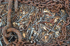 Background of old rusty bent nails, bolts, nuts, screws, chain. Background of old rusty bent nails, bolts, nuts, screws and big chain Royalty Free Stock Photography