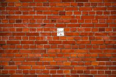 Background with the old shabby brick wall Stock Photos