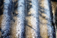 Background of old slate roofing plate texture. And shadows on it Stock Images