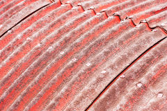 Background of old slate with tattered red paint on the roof, bok Royalty Free Stock Images