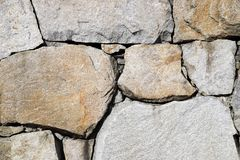 Background of stone wall texture. Background of old stone wall texture, close up Stock Photos