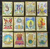 Background with old tarot cards. Background with the tarot cards, top view. The major arcana deck. Fortune telling seance or black magic ritual. Scary still life royalty free stock photography