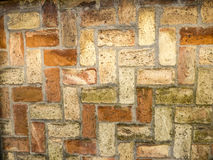 Background old vintage brick wall. Background vintage old brick wall close up Stock Image