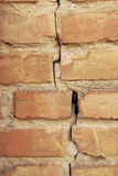 Background of old vintage brick wall. Background crack in the insulation of old vintage brick wall Royalty Free Stock Photography