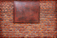 Background of old vintage brick wall.cracked concrete vintage brick wall background.free space for text in wood banner. Stock Image